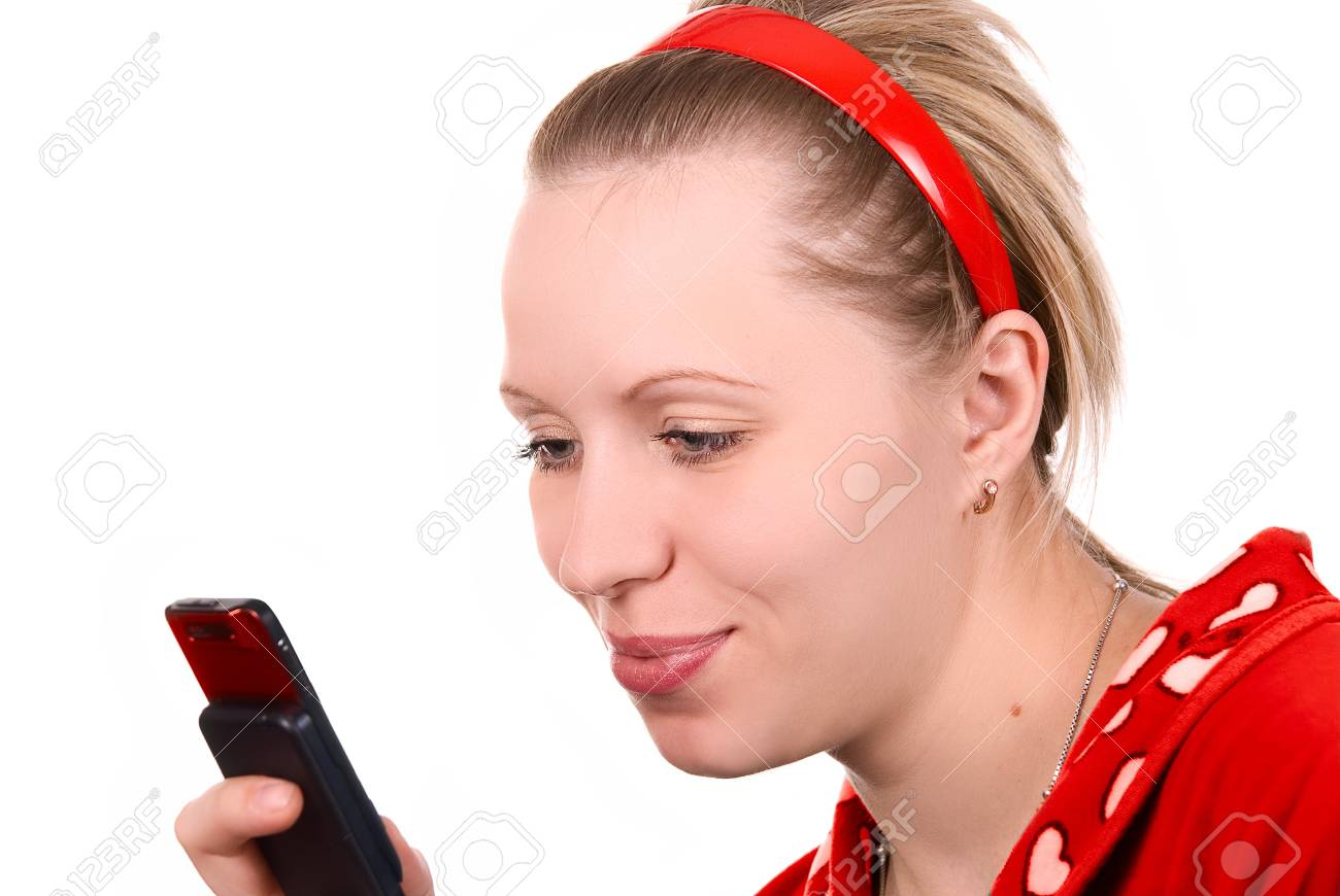 Girl in red with mobile phone on white Stock Photo - 4496351