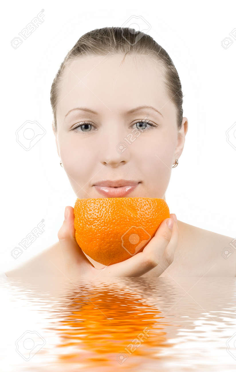 Pretty girl with orange fruit in water Stock Photo - 4579875