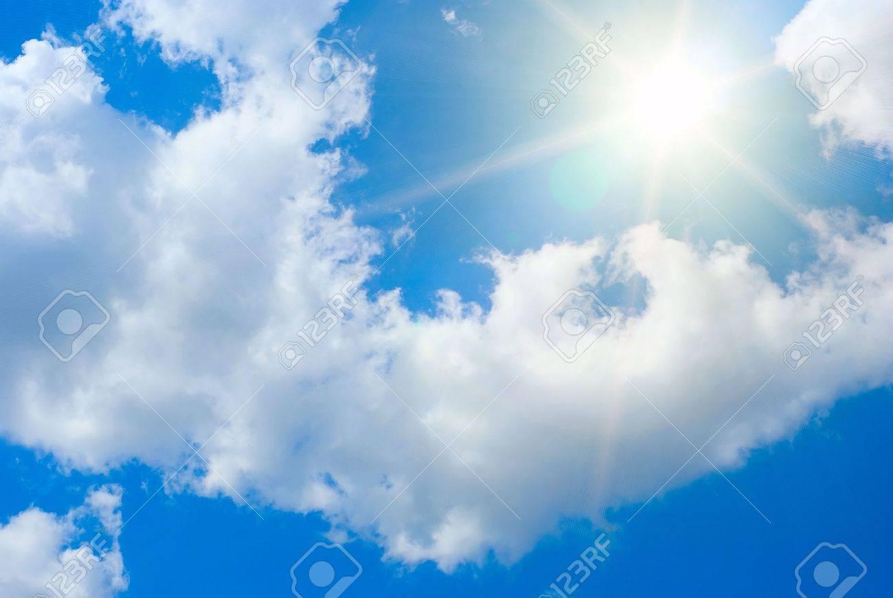 Sun rays against a blue summer sky Stock Photo - 4951295