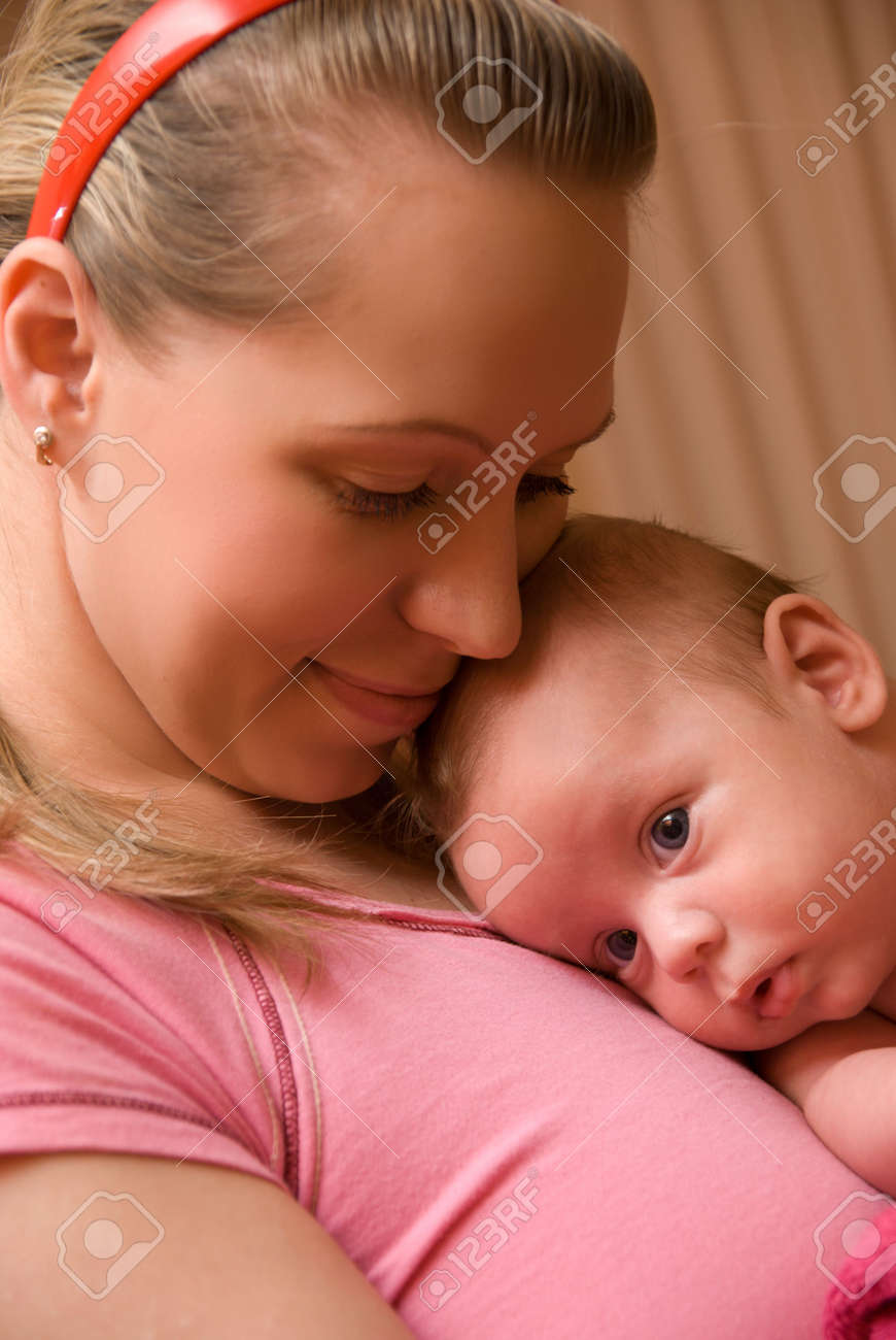 Happy maternity: mother with her baby boy Stock Photo - 5616017