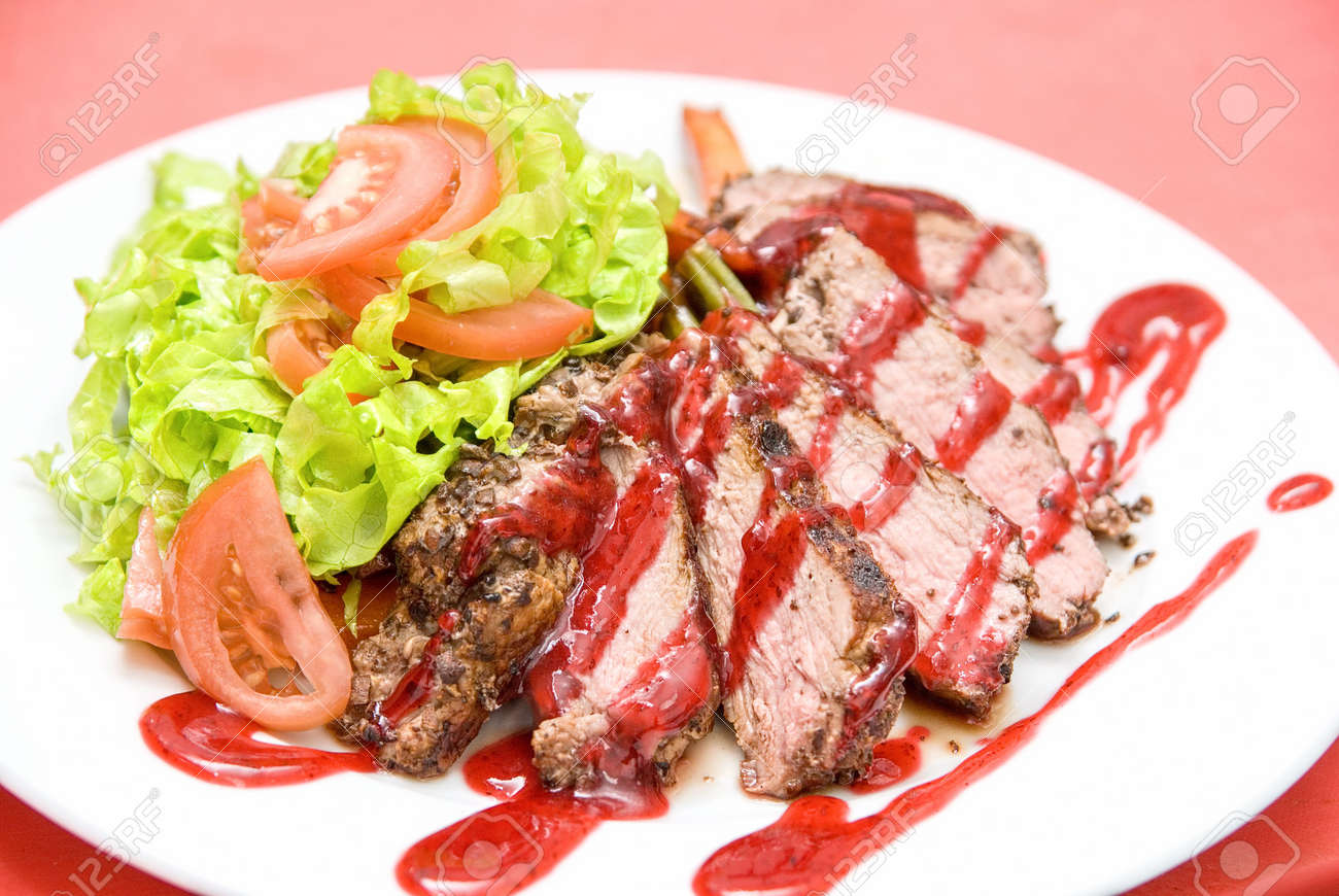 Roasted Beef meat at cranberries sauce with vegetables Stock Photo - 6357491