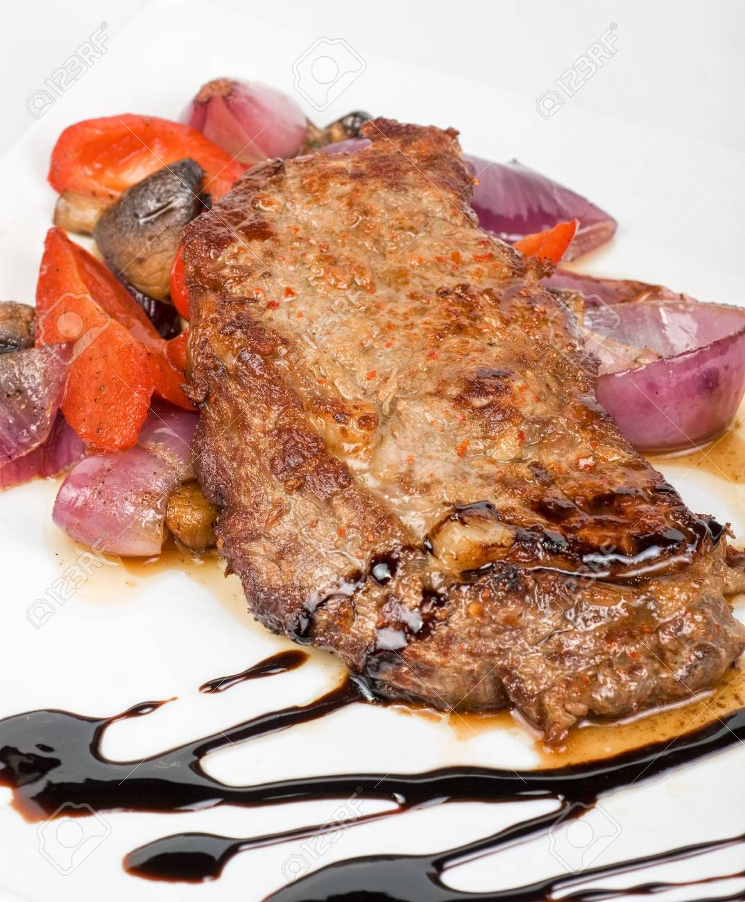 Grilled beef steak with vegetable closeup at plate Stock Photo - 6870965