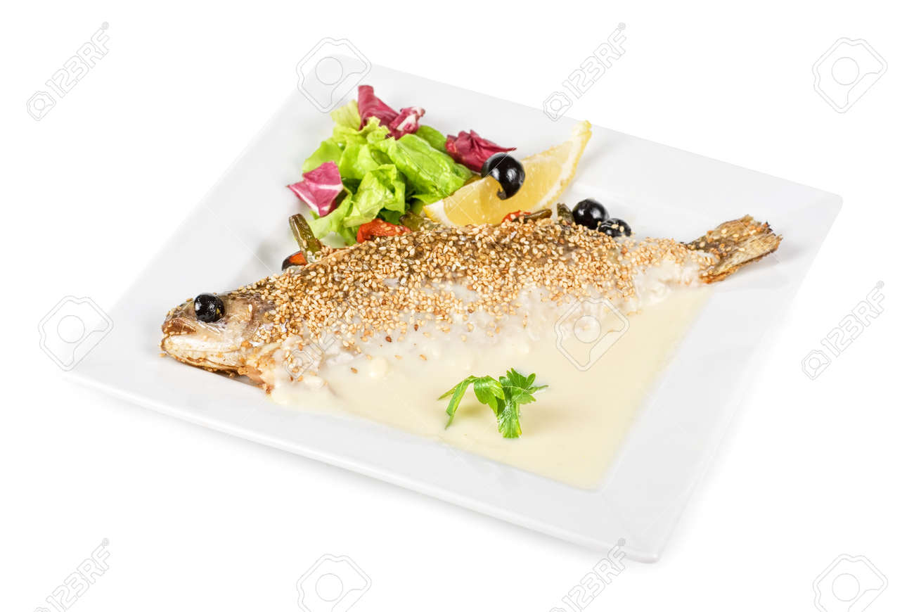 fish with lemon and greens on white background Stock Photo - 7185733