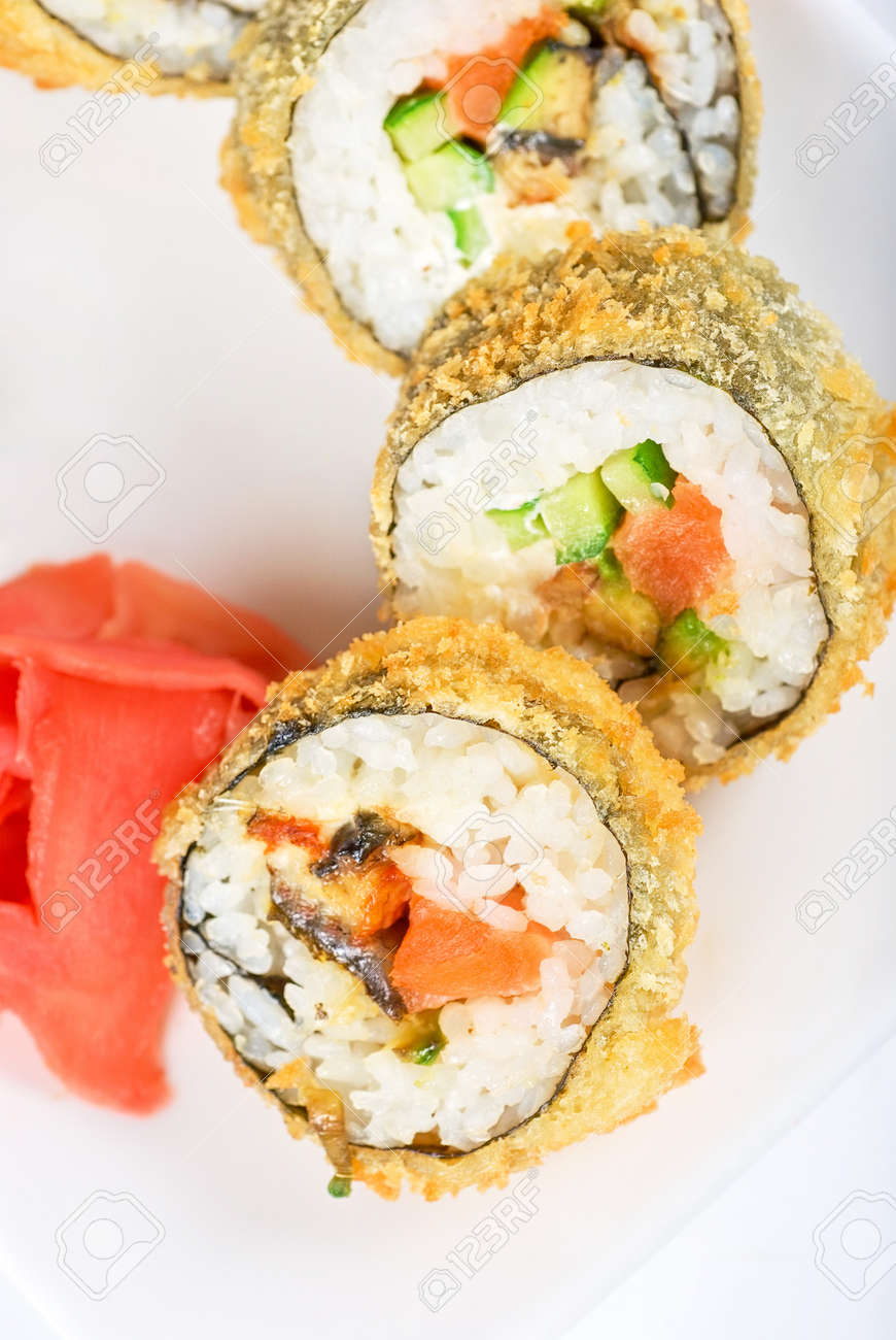 Sushi rolls at plate isolated on a white Stock Photo - 7434232