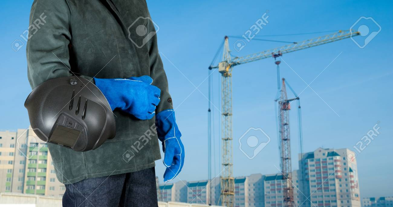 male welder closeup with welding equipment on building background Stock Photo - 7570647