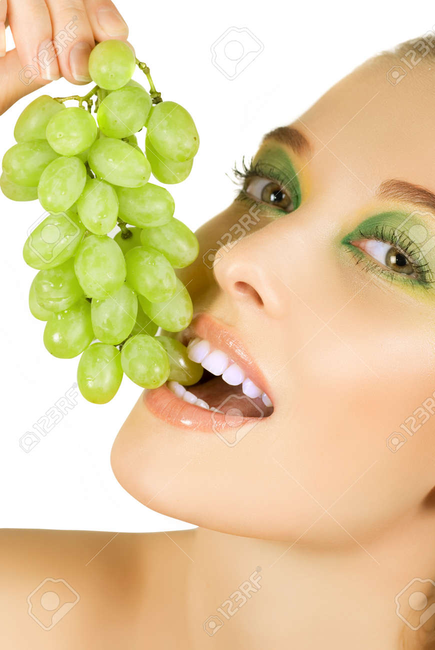 Pretty young woman closeup with grape on the white background Stock Photo - 7649390