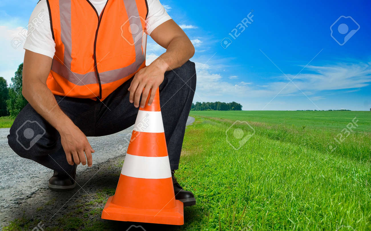 road worker closeup with orange posts at road Stock Photo - 7699806