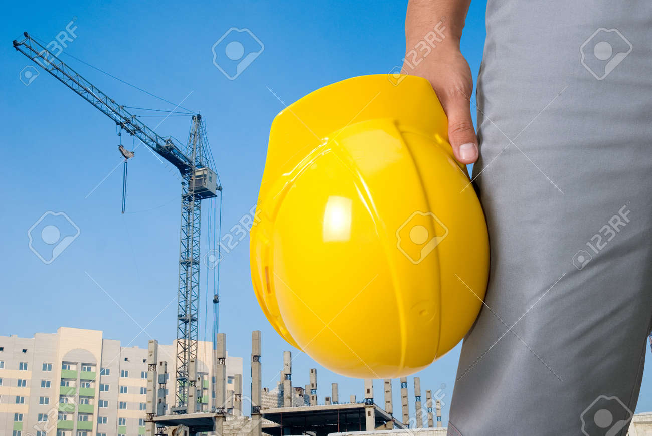 Closeup of builder with yellow helmet on building panorama background Stock Photo - 7699909