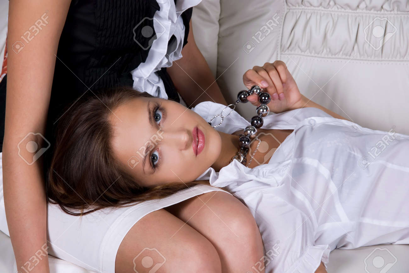 brunette women portrait closeup, lying at legs of other girl Stock Photo - 7816343