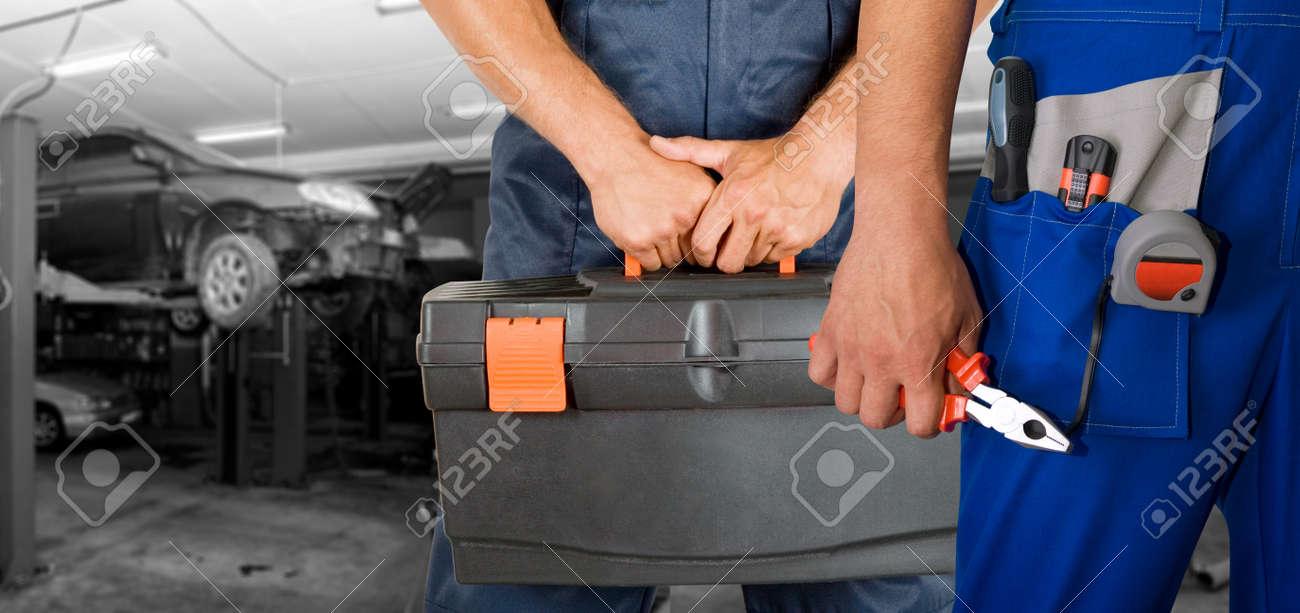 Auto mechanics closeup over workshop background Stock Photo - 8138131