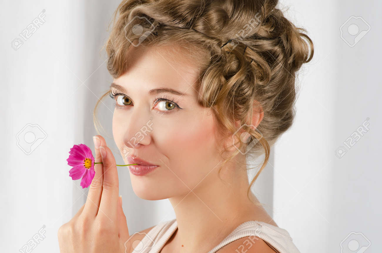beauty woman closeup portrait with flower over grey background Stock Photo - 10882236