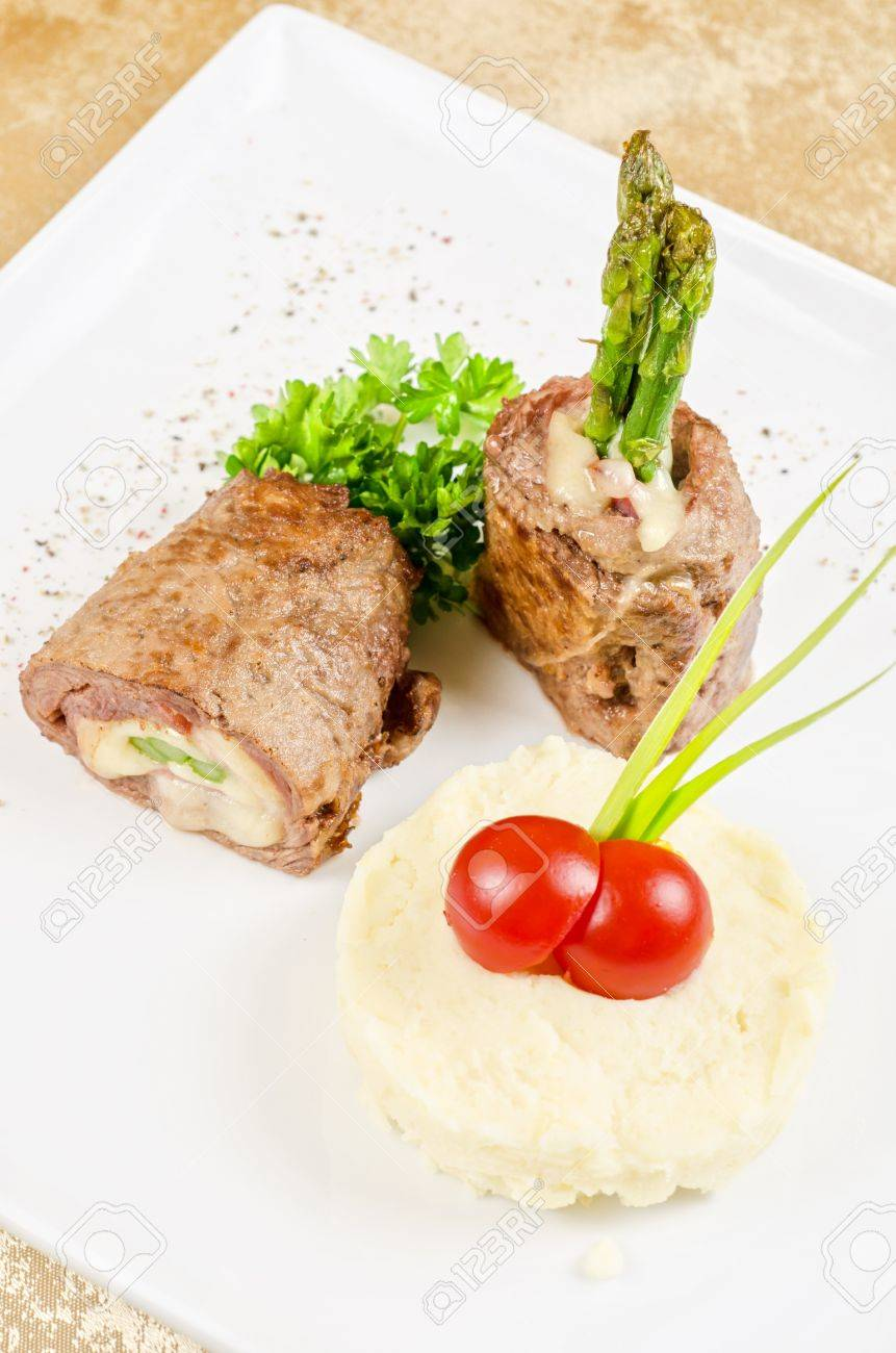 Grilled Meat Rolls From Beef Meat With Mozzarella Ham Asparagus And Mashed Potatoes Stock