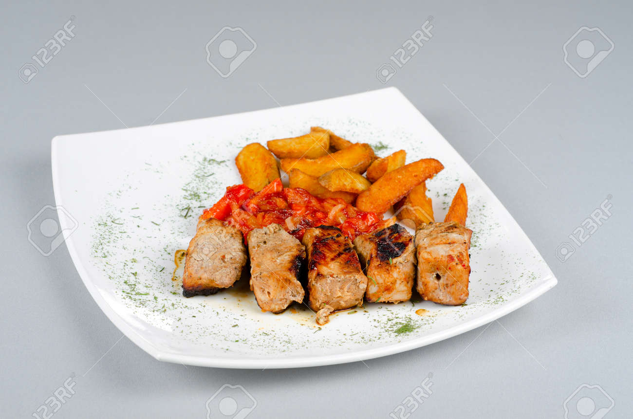 Grilled kebab pork meat with roasted potato and vegetables Stock Photo - 14168641