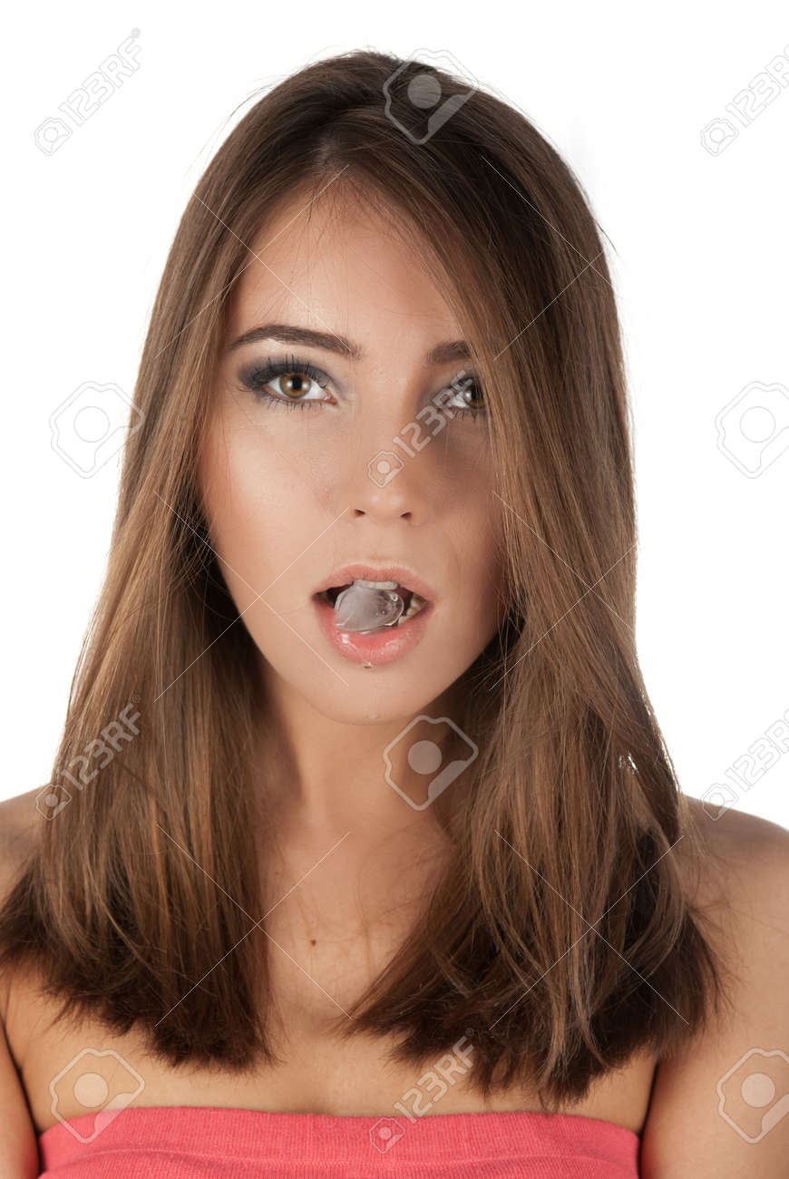 Beautiful girl hold ice cube in mouth and eat it Stock Photo - 14378835
