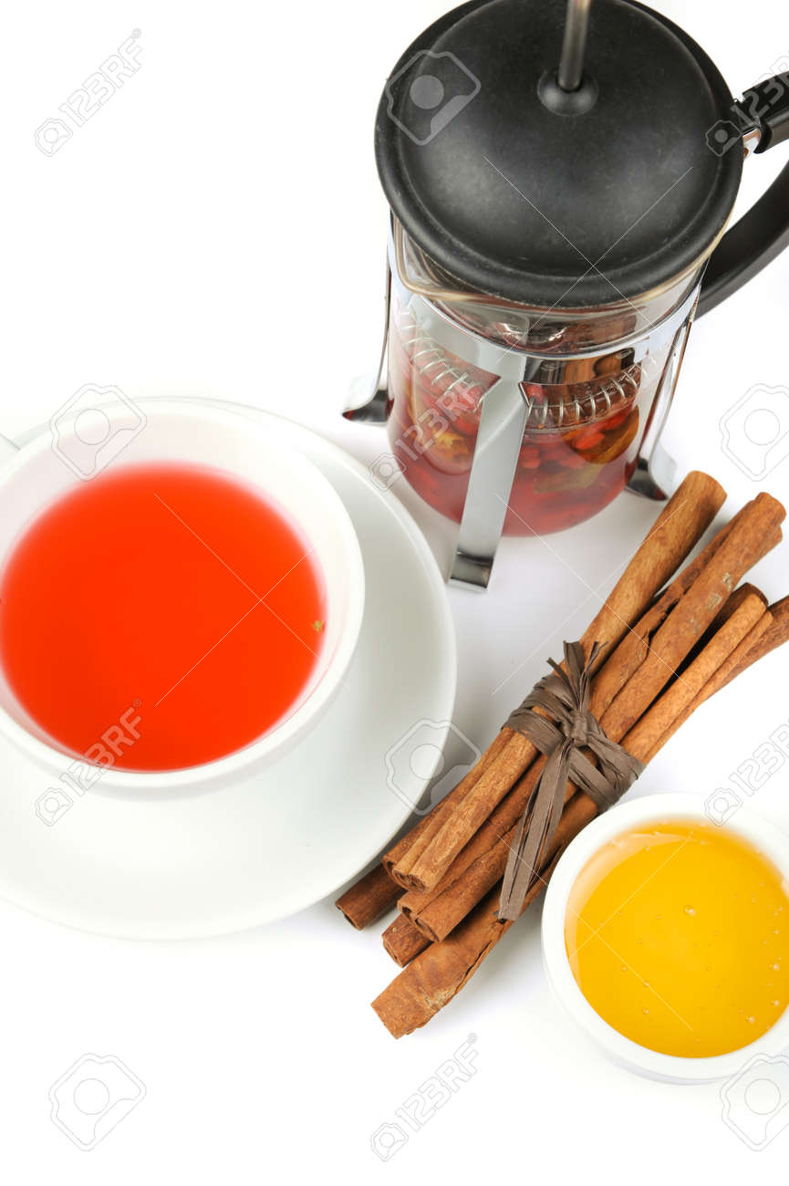 Cup of hot berries tea with cinnamon sticks, and honey Stock Photo - 16066101
