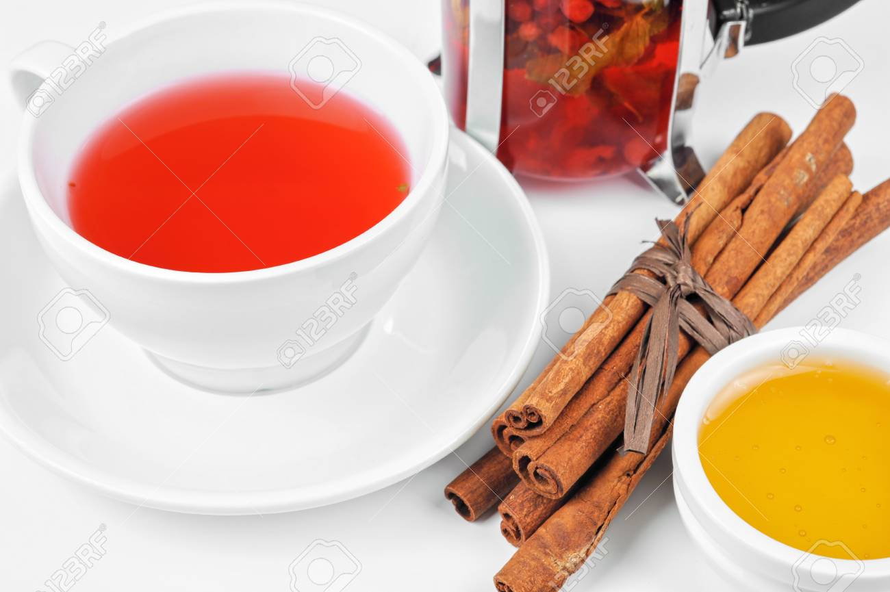 Cup of hot berries tea with cinnamon sticks, and honey Stock Photo - 16066104