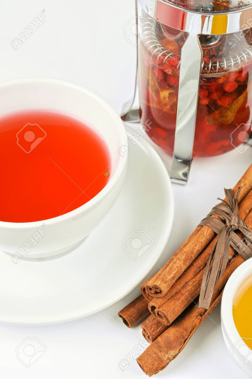 Cup of hot berries tea with cinnamon sticks, and honey Stock Photo - 17767764