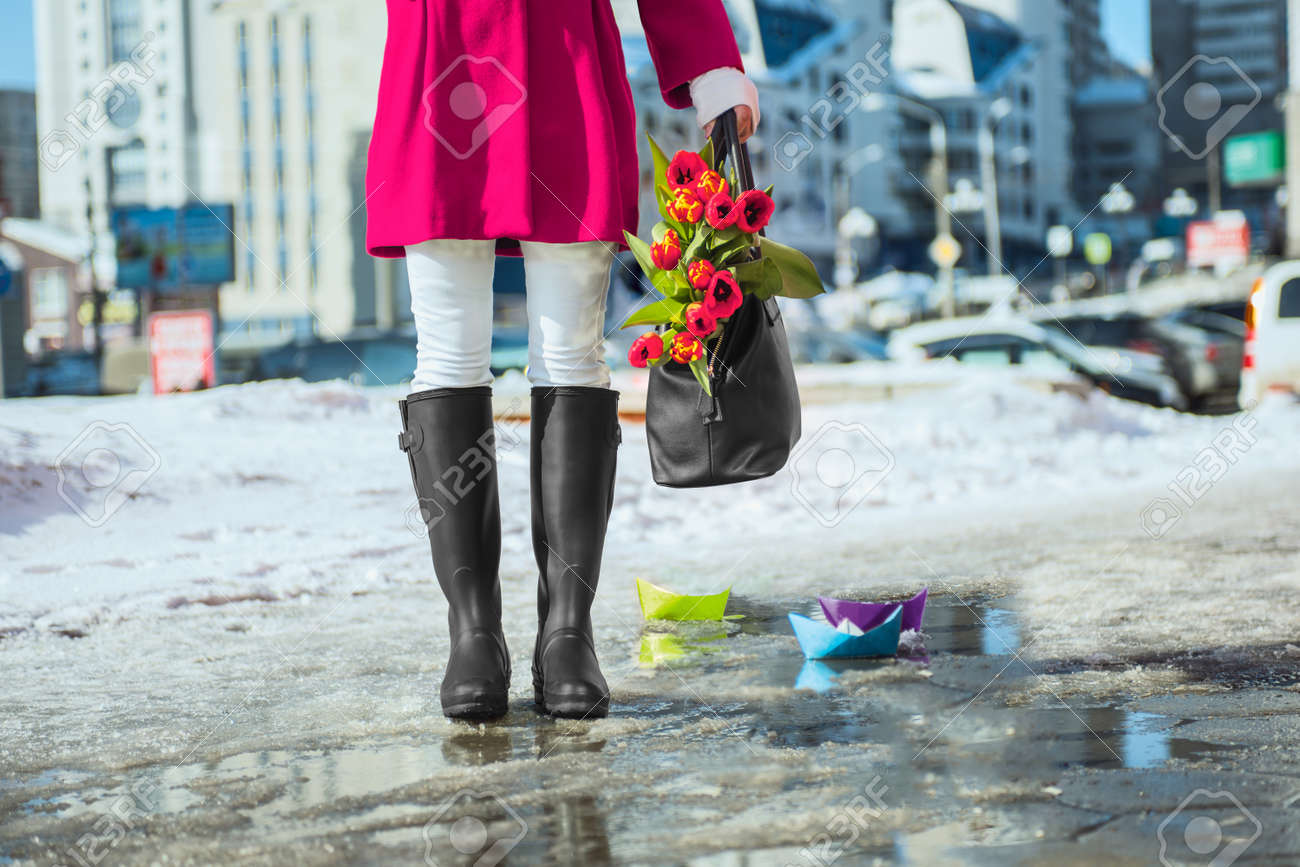 Woman Wearing Rain Boots Stay Into A Puddle Stock Photo, Picture ...