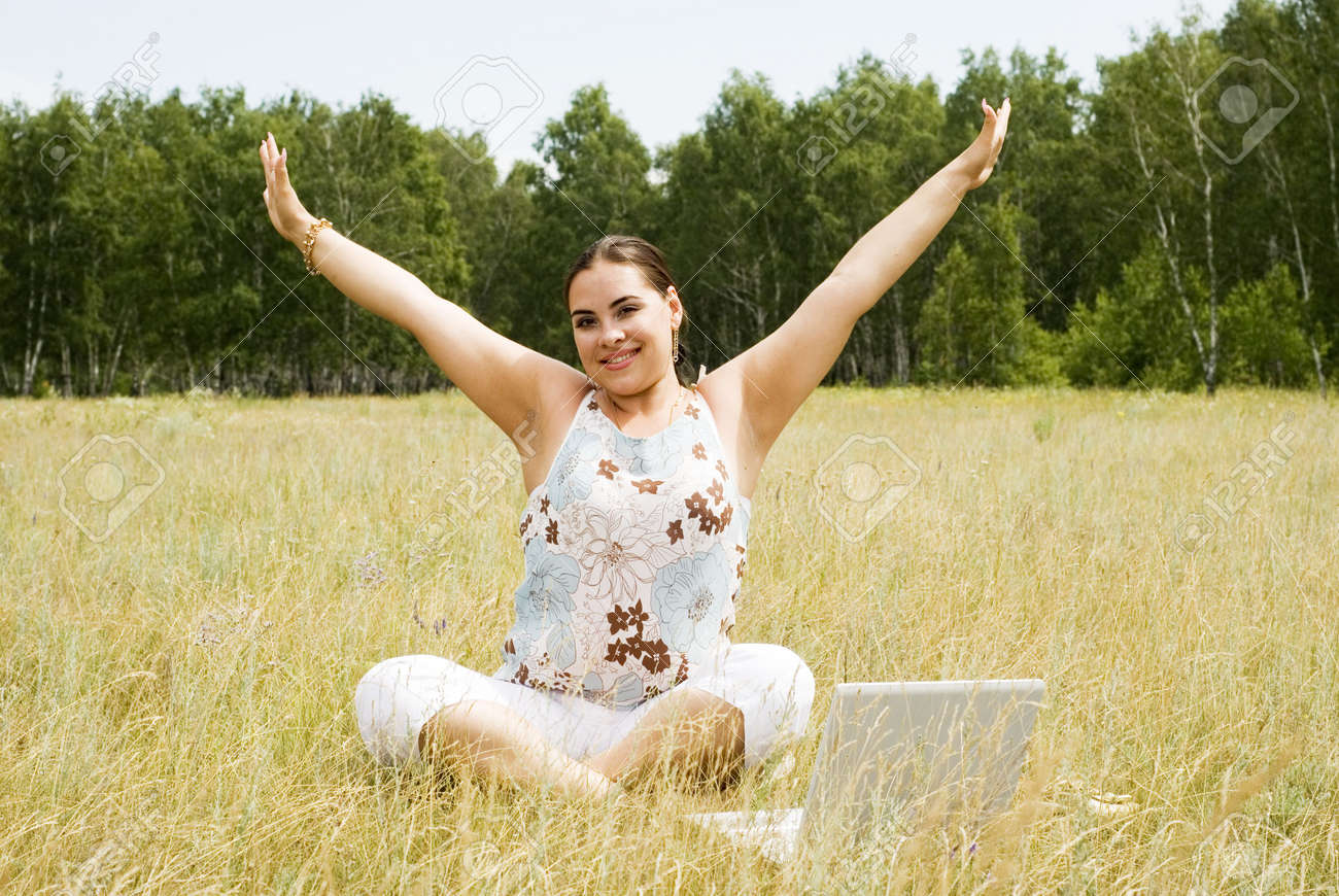 beautiful woman with laptop on the grass Stock Photo - 3297183