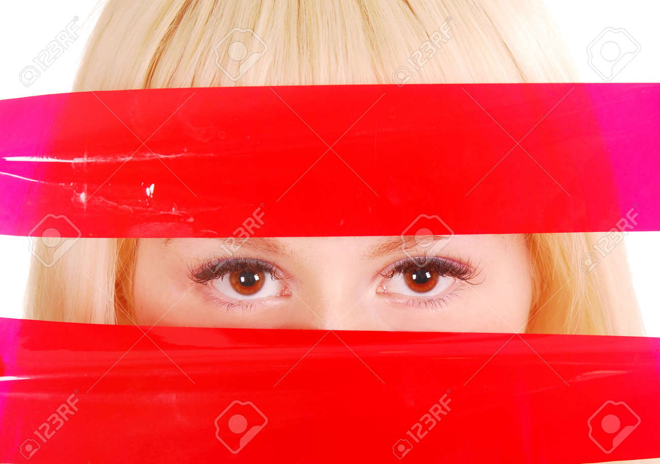 eyes looking through red ribbons Stock Photo - 7858380