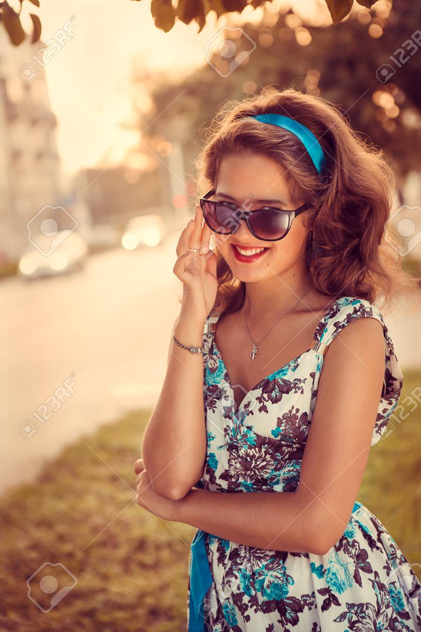 American redhead girl in suglasses. Photo in 60s style. Stock Photo - 22469657