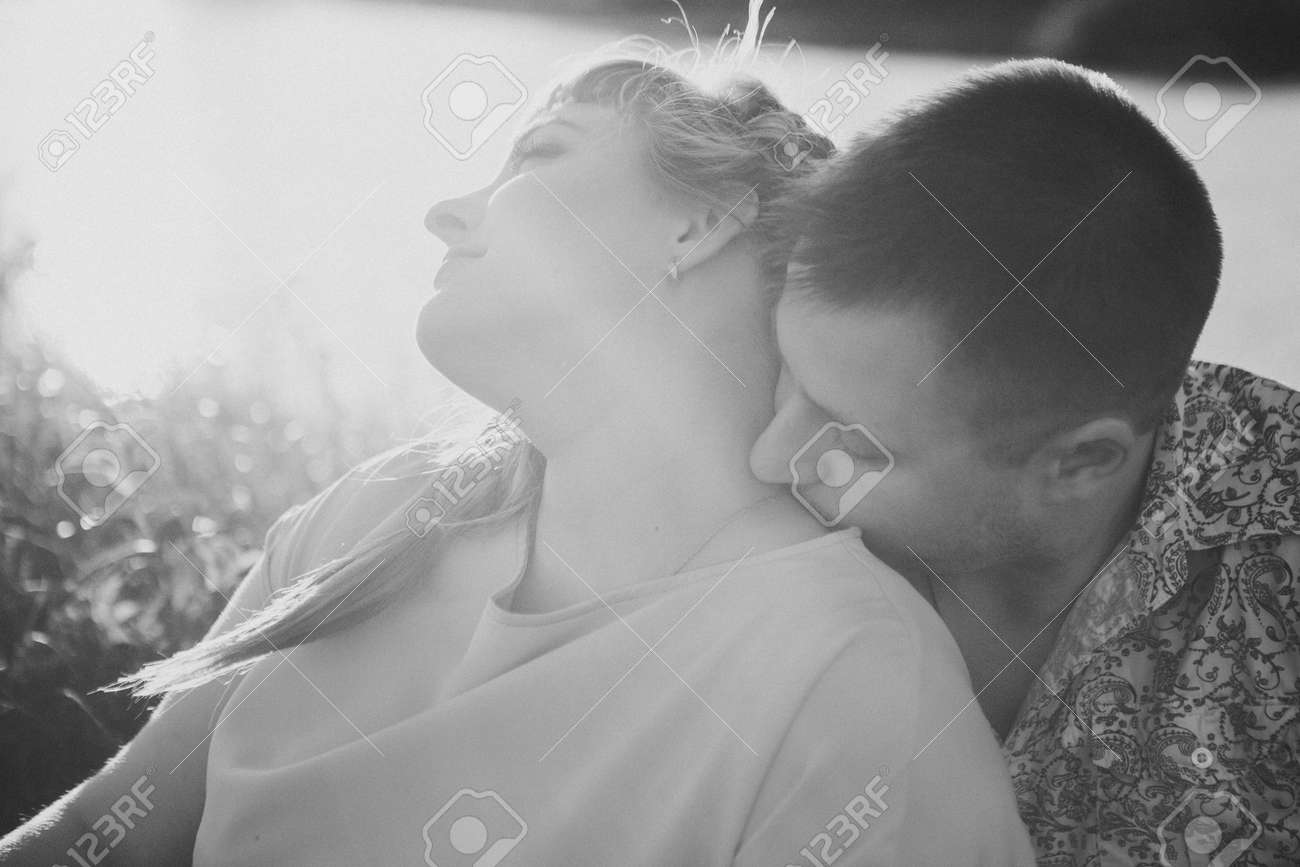 Romantic black white photo couple sit and kissing on background summer lake stock photo 47073294
