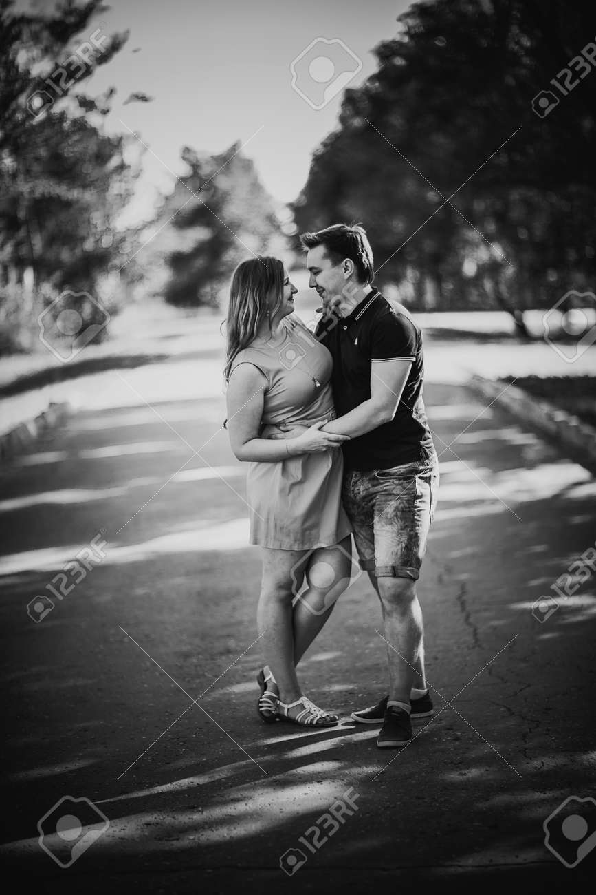 Black white photography romantic young couple laugh on background