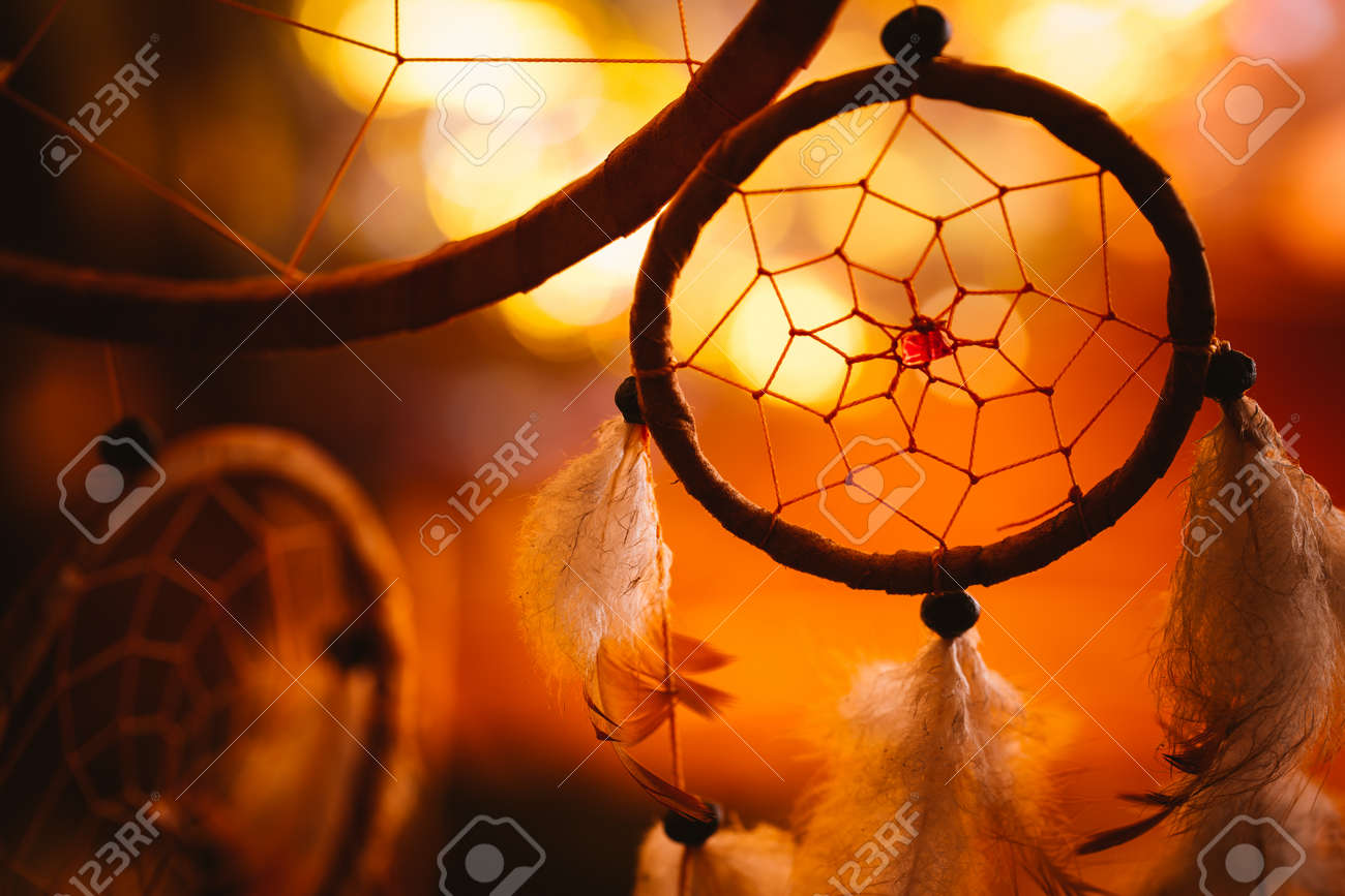 black and white photo of a dream catcher at sunset purple dark background. - 61656557