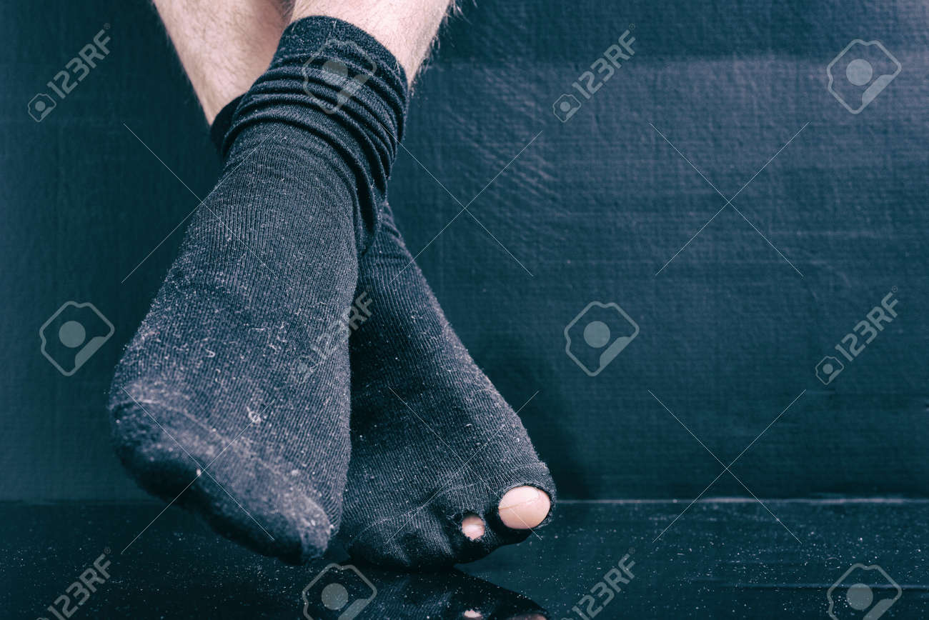 special for shoe attractive style cheap price Legs bankrupt in black holey socks on a black background.