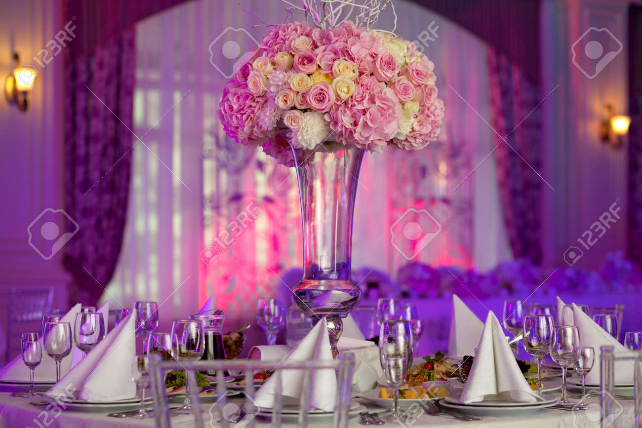 Table setting at a luxury wedding reception. Beautiful flowers on the table. Stock Photo - 46935518