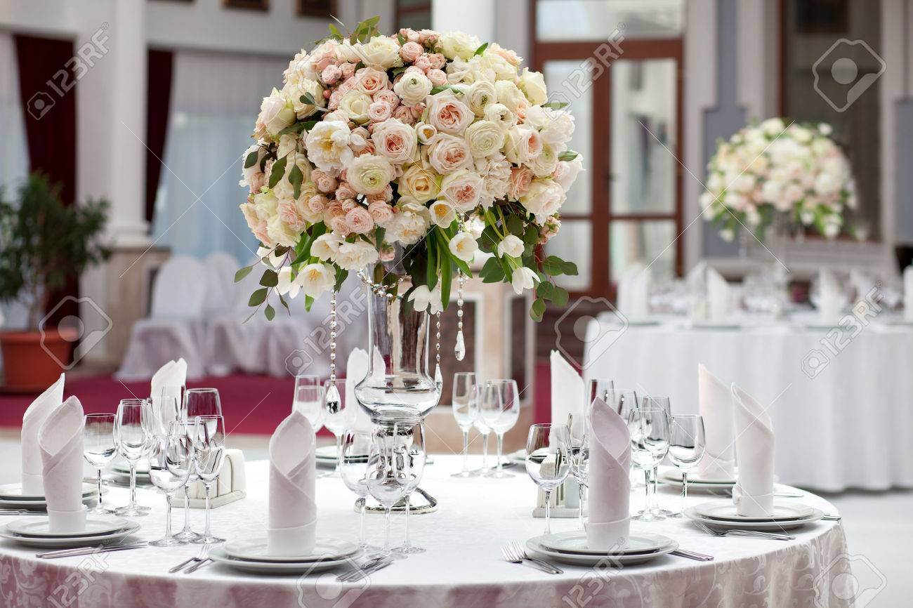 Stock Photo - Table setting at a luxury wedding reception. Beautiful flowers on the table. & Table Setting At A Luxury Wedding Reception. Beautiful Flowers ...