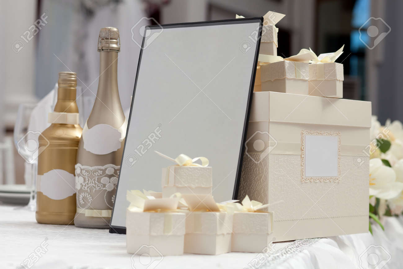 Champagne Bottles And Gift Boxes As A Wedding Decoration In ...