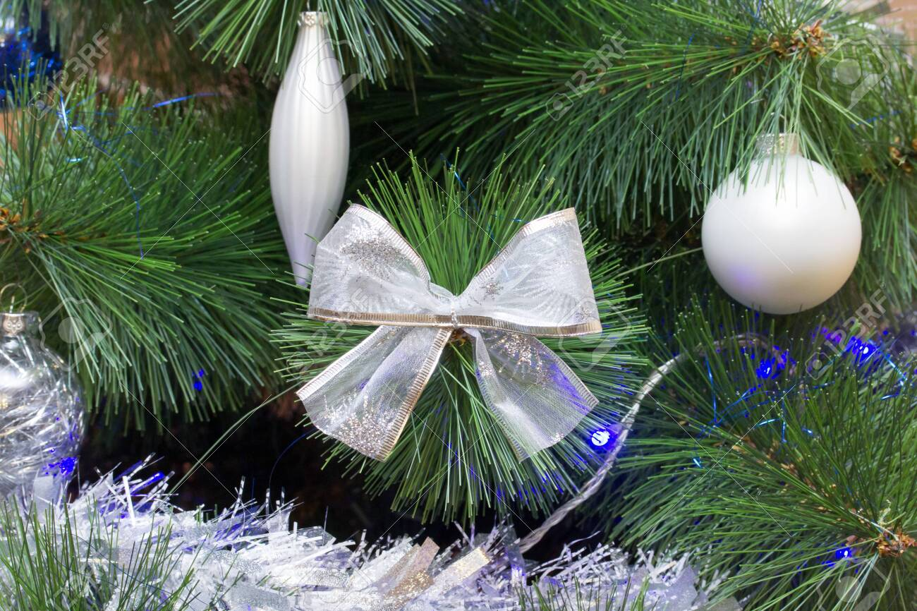 Christmas Tree Branch With A Large Bow Decorated In Two Color Stock Photo Picture And Royalty Free Image Image 118384622