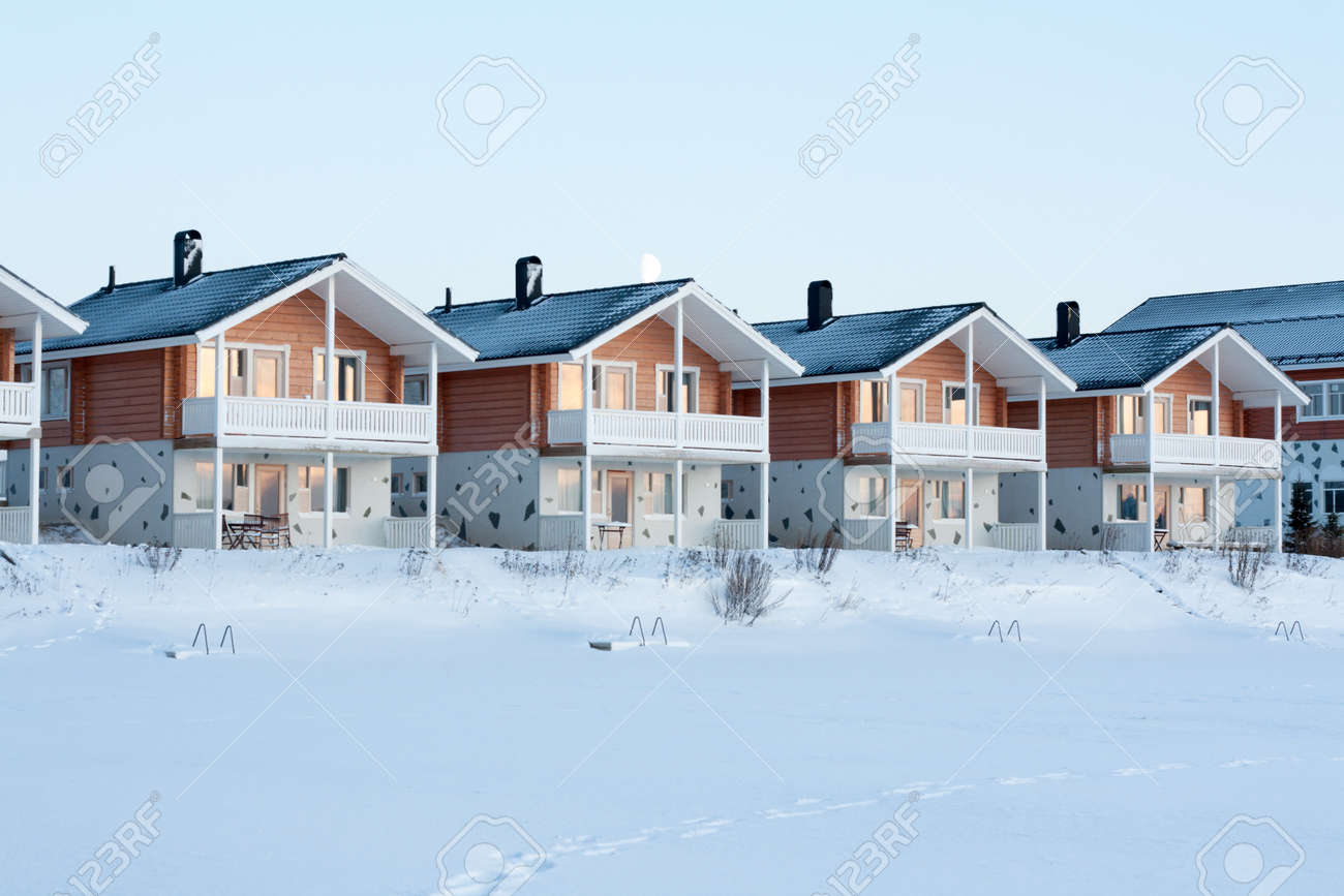Lodges in snow, sundown, moon, winter, sky Stock Photo - 4549776