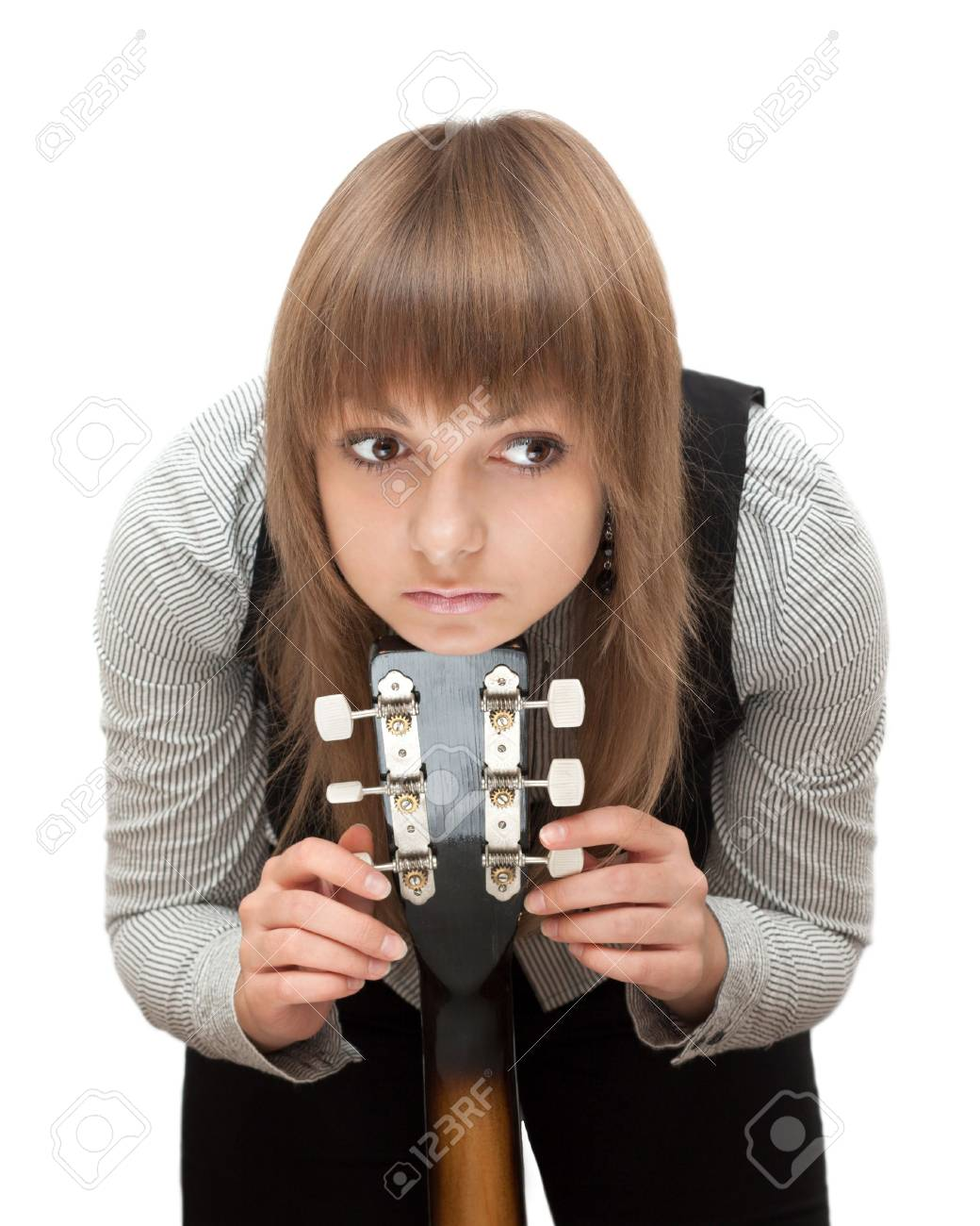 Portrait young girl with guitar on white background Stock Photo - 5582579