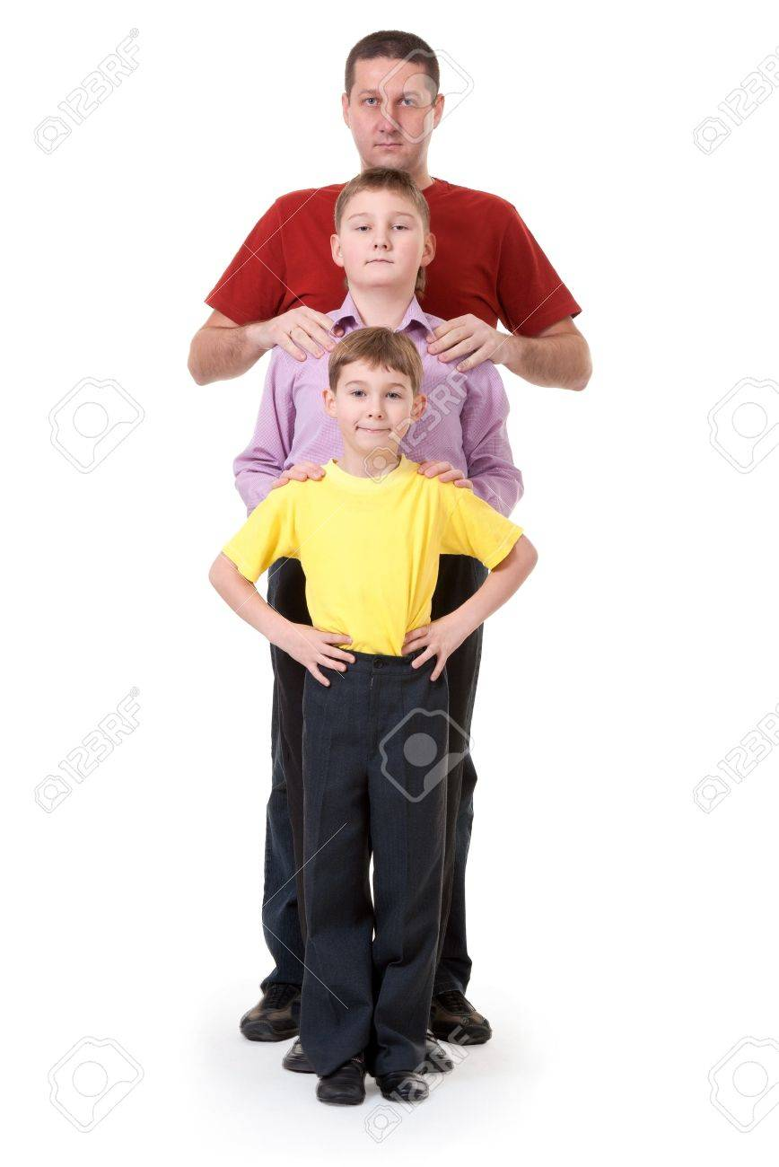 Dad and two sons are in a row on a white background Stock Photo - 8557903