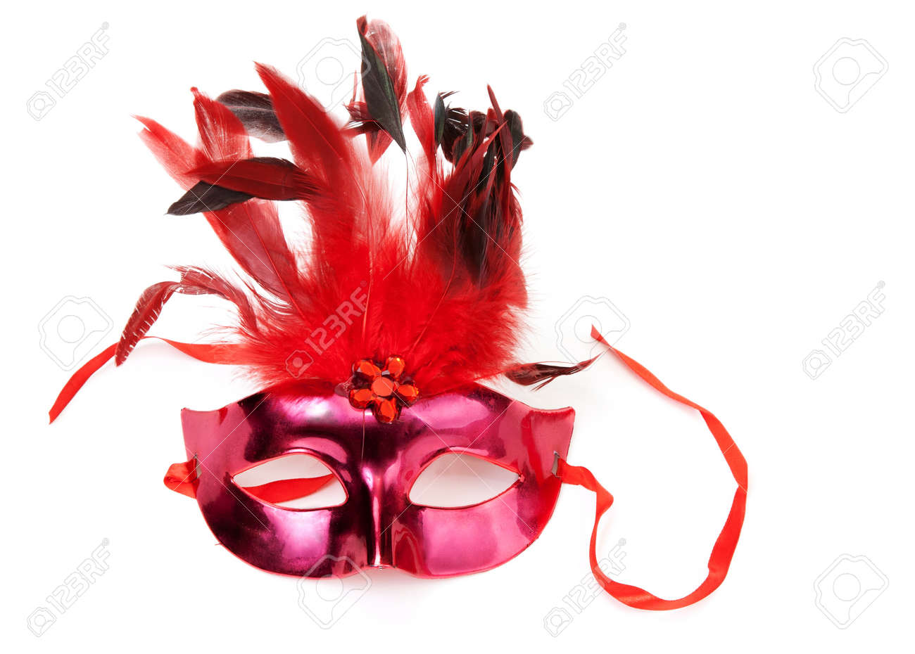 Red mask with feathers on a white background Stock Photo - 8590391