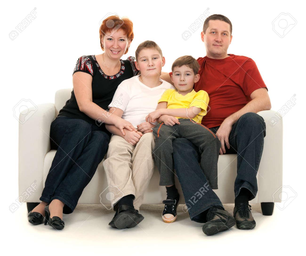 Family of four on a sofa on a white background Stock Photo - 8590375