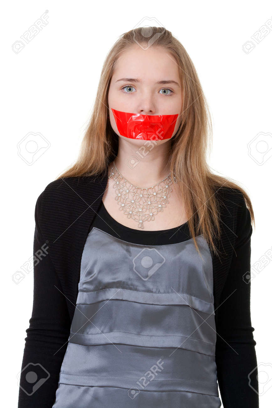 beautiful girl with her mouth sealed with red tape Stock Photo - 8699871