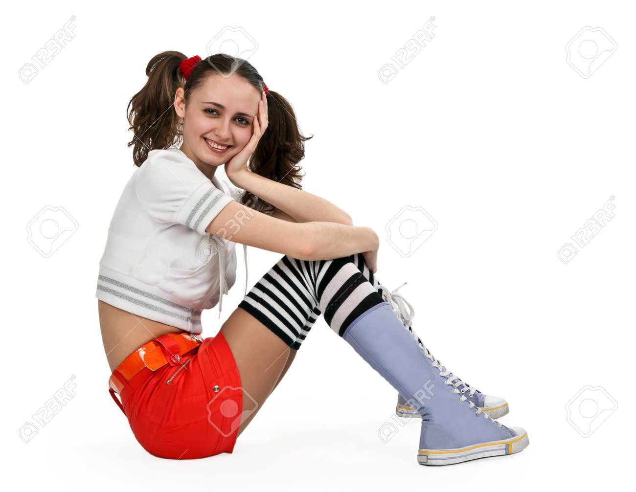 Девочка в мини юбке сидит