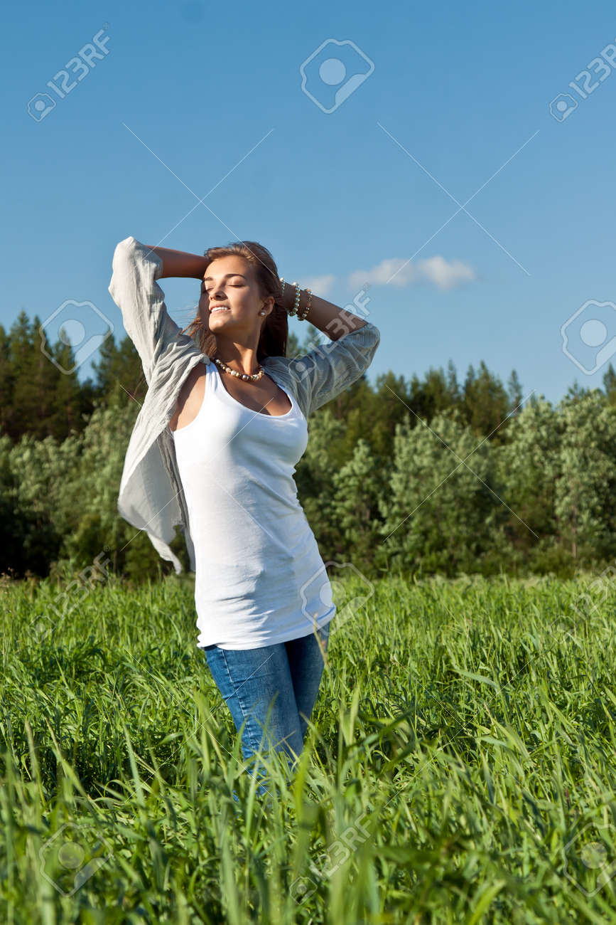 portrait of a beautiful young girl on green grass Stock Photo - 10121401