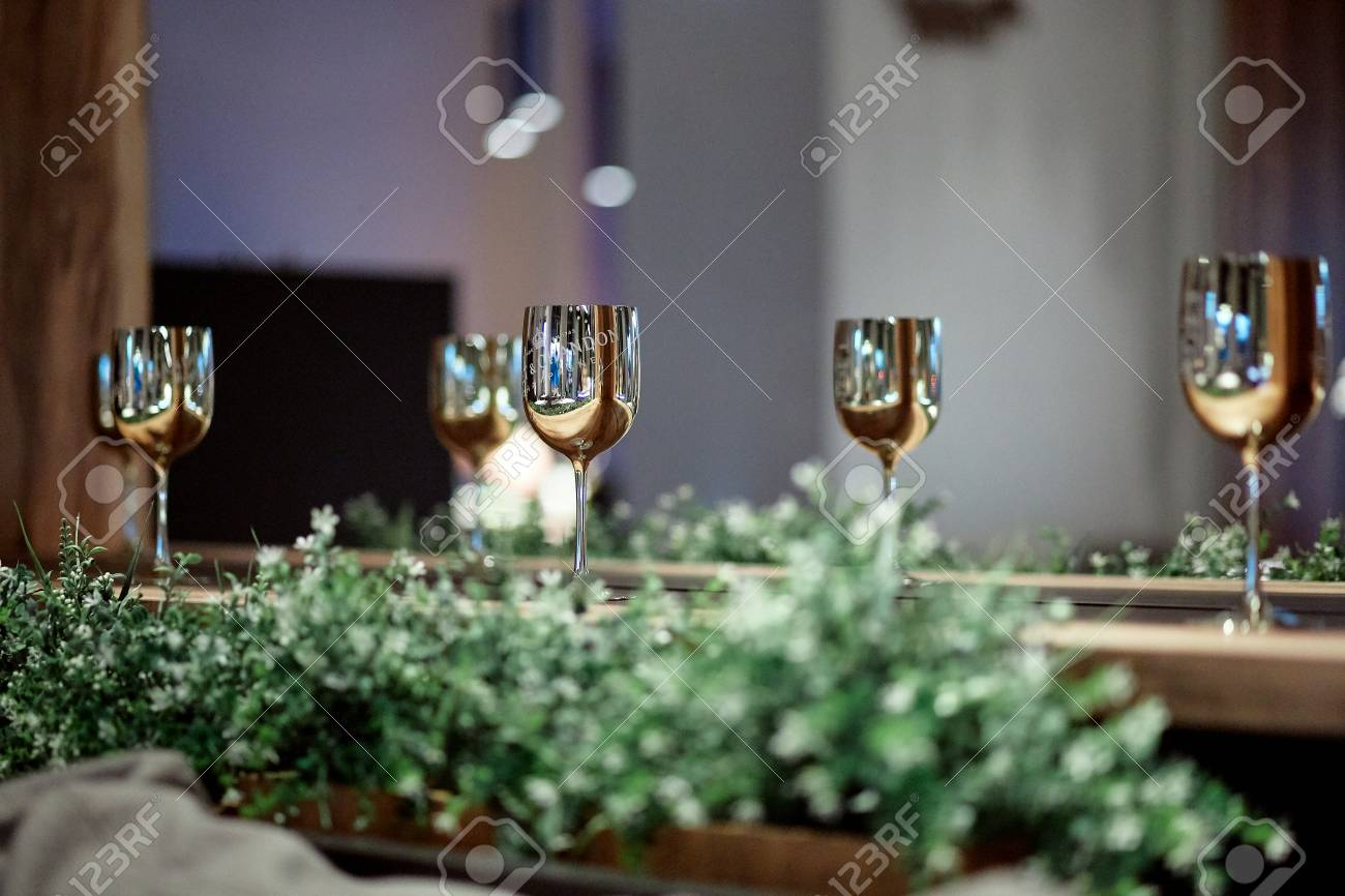 5f5bb017eac Stock Photo - Great photo of amazing golden wine glasses