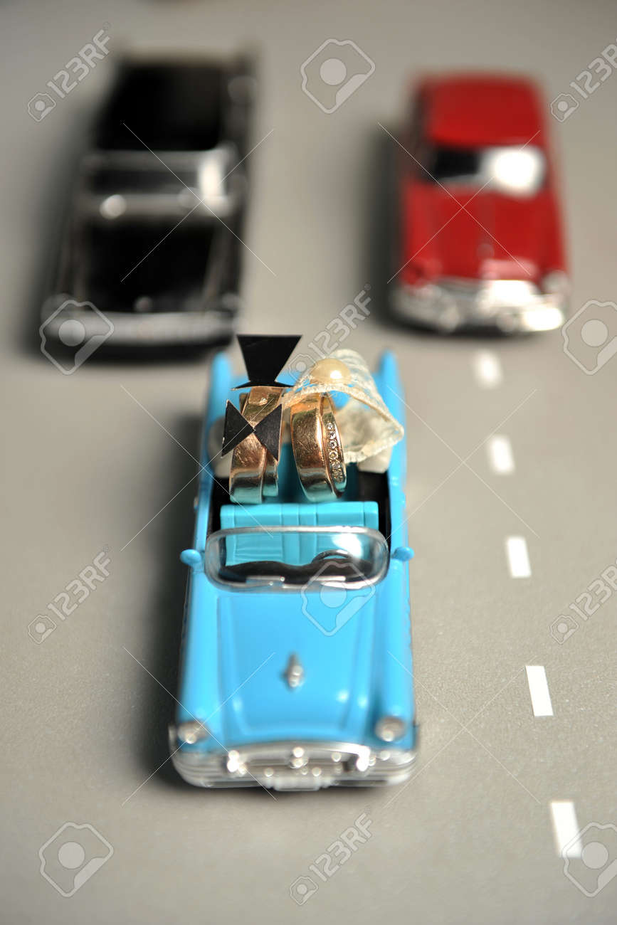 Gold Wedding Rings Lie In The Small Blue Toy Car To Funny
