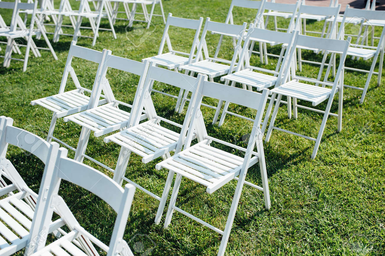 Rows Of White Folding Chairs On Lawn Before A Wedding Ceremony Stock Photo Picture And Royalty Free Image Image 61594976