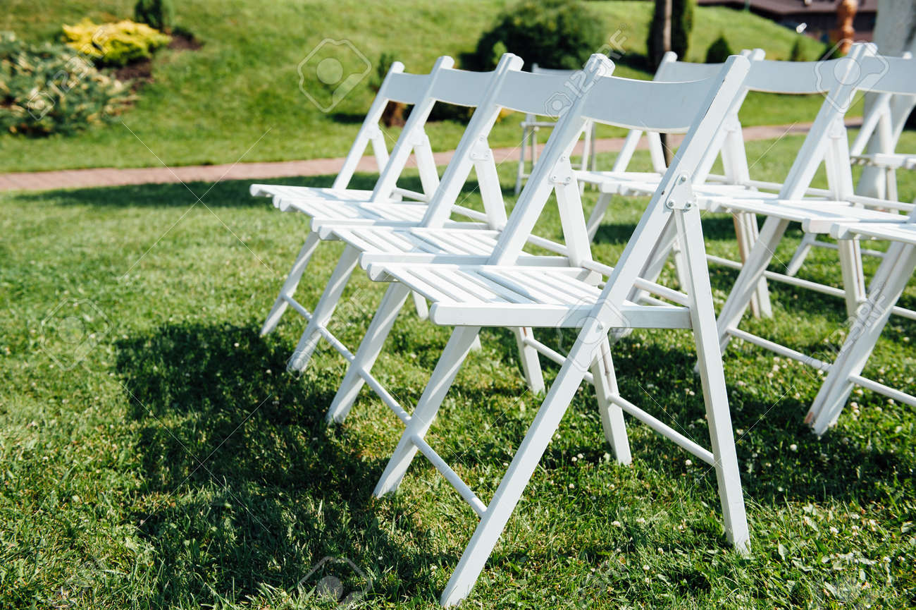 Rows Of White Folding Chairs On Lawn Before A Wedding Ceremony Stock Photo Picture And Royalty Free Image Image 61598685