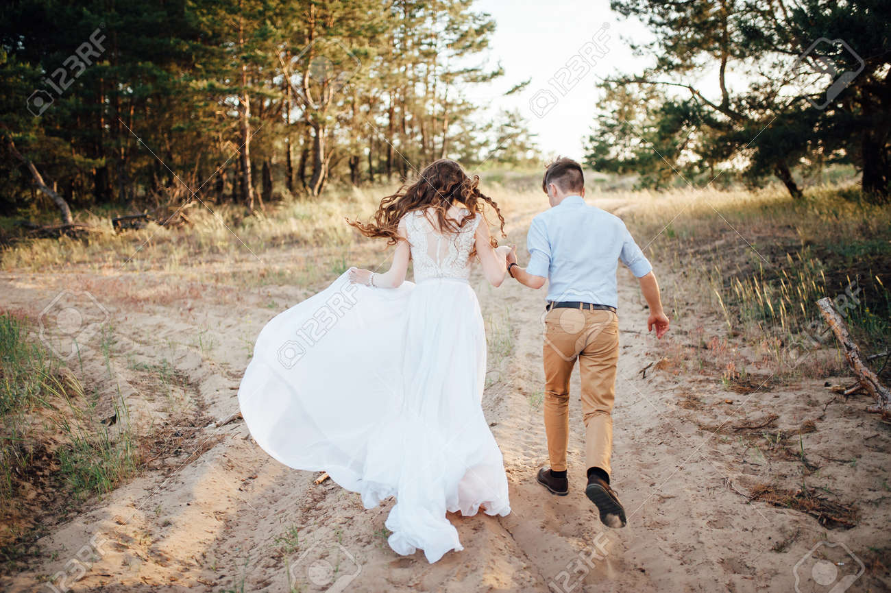 Just Married Loving Hipster Couple In Wedding Dress And Suit.. Stock ...