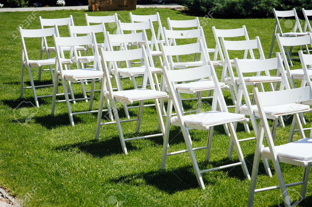 Rows Of White Folding Chairs On Lawn Before A Wedding Ceremony Stock Photo Picture And Royalty Free Image Image 124149792