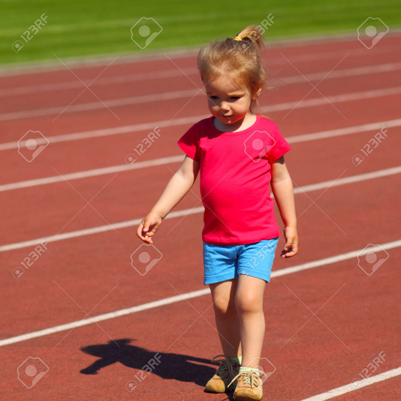 little girl athletics little girl child involved in athletics at the stadium