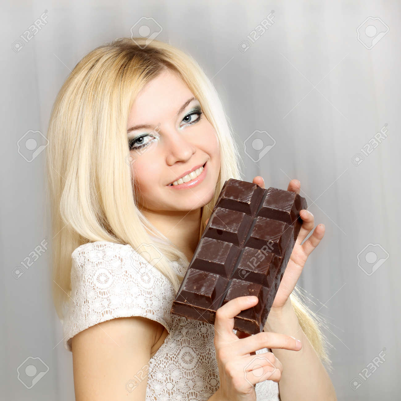 Nice Natural Cute Blonde Girl Eating A Large Bar Of Chocolate ...