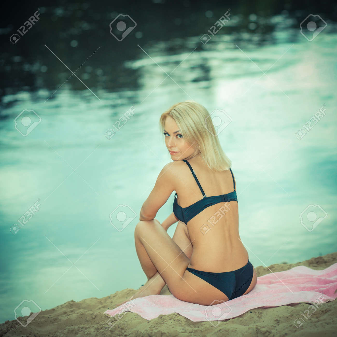 f6ff321a90d57 beautiful girl in a black bikini on the beach. Outdoor portrait of tanned girl  having